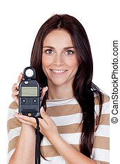 Beautiful brunette girl with a photometer
