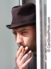 man smoking cigar - Portrait of a young man smoking cigar