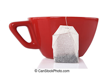 Red Ceramic cup with tea bag - reflection of Red Ceramic cup...