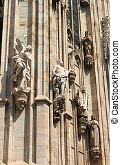 Statues in the Milan cathedral - Statues embossed in the...