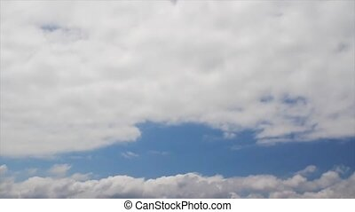 Time Lapse Clouds Loop widescreen - Bright white clouds fly...