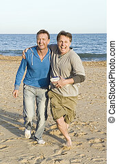 Happy gay couple - A happy gay couple having fun on the...