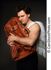 Mr. Angel with brown bag