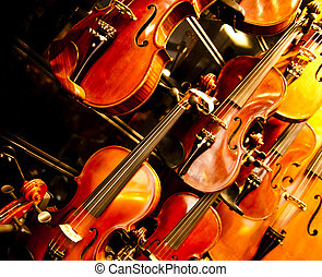 Violins hung on a wall - New violins hung on a wall as a...