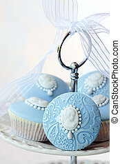 Cameo cupcakes - Cupcakes decorated with embossed fondant...