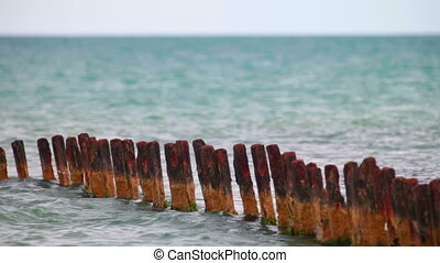 old pier - rusty remnants of the destroyed pier