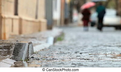 car on wet cobbled road - car driving on rainy cobblestones...