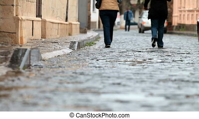 rainy cobbled street - Walking on  rainy cobbled street