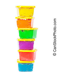 Plasticine - A stack of jars with plasticine of different...