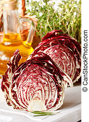 Radicchio. - Two half radicchio lettuce on a white kitchen...