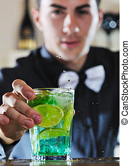 pro barman prepare coctail drink on party - pro barman...