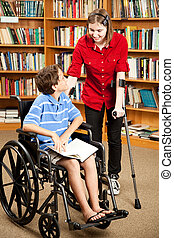 Disabled Kids in Library - Disabled teen with forearm...