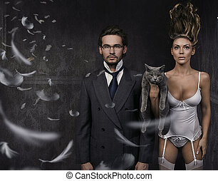Handsome man, attractive brunette and cat