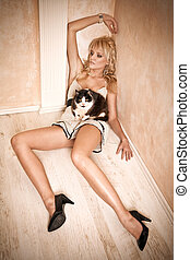 Attractive blonde lying on a room's corner