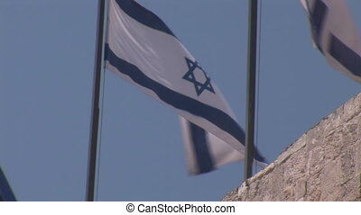 flag of israel flies over the Tower of David