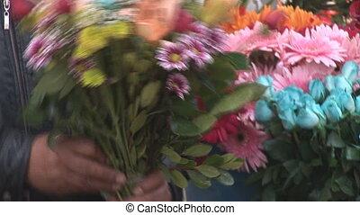 flowers - Man sells the flowers