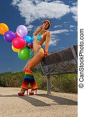 Sexy bikini girl with colorful ball