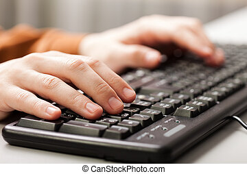 Hand typing computer keyboard - Business human hand working...
