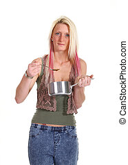 Woman eating soup out of a saucepan