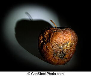 Rotten apple in dark. Play with light.
