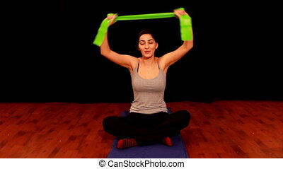 young woman doing pilates 2
