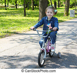 child riding bicycle