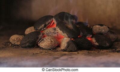 Closeup of hot wood briquettes in t
