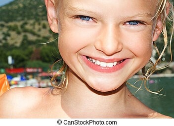 Young girl on sunny vacation day