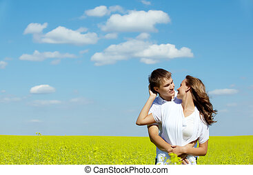 Love - Image of happy couple in yellow meadow at summer