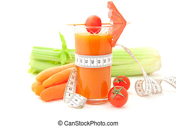 Glass of vegetable juice with tape measure and fresh...