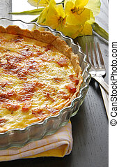French pie Quiche Lorraine On the table with flower