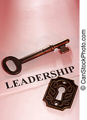Key to Leadership - A key laying on a piece of paper with...