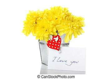 Yellow chrysanthemums in a pail - Yellow chrysanthemums in a...