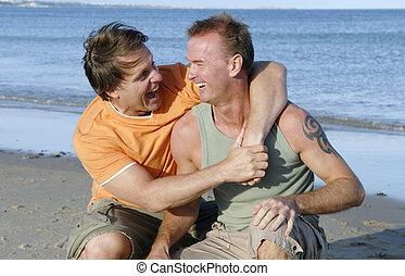 A happy gay couple on the beach