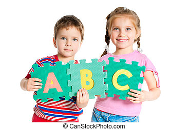 boy and girl holding letters - boy and girl are holding...