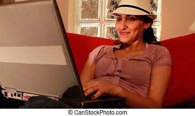 young woman on computer laughing 2