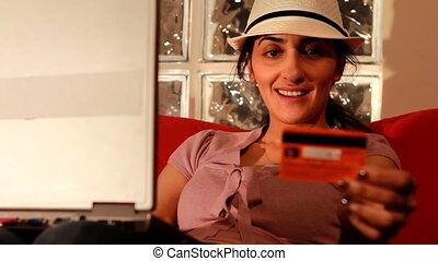 young woman buying online with credit card