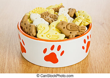 Dog treats biscuits - Dog bowl full of treats biscuits in...