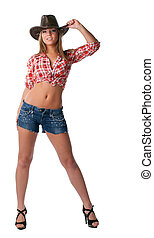 Beautiful sexy cowgirl stand in shorts isolated