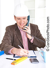 Architect working in office - Architect looking working in...