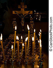 Cross and candles - Crucifix and a lot of candles in church....