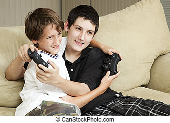 Brothers Playing Video Games - Two affectionate brothers...