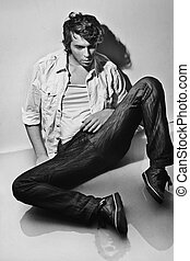 Young handsome man lying on the floor