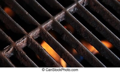 Flaming Grill Loop - A barbecue grill iron grate with...