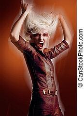 Cute blonde in vampire look