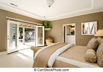large bedroom, modern design with french doors open to pool...