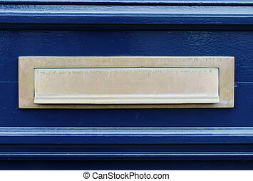 Blue door with letterslot mailbox - Detail of a blue door...