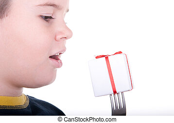 Boy and a plug with a gift on a white background
