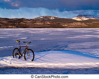 Bike on frozen Lake Laberge, Yukon, Canada - Bicycle on ice...