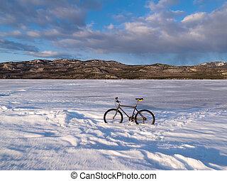 Bike on frozen Lake Laberge, Yukon, Canada - Bicycle on ice...